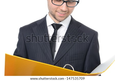 Young businessman with file binder isolated on white