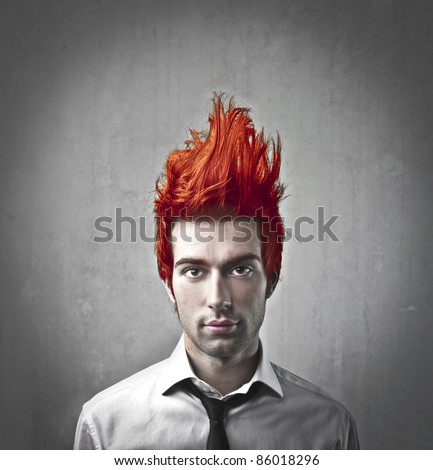 Young businessman with flaming hair up in the air - stock photo