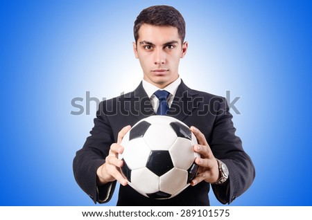 Young businessman with football against the gradient - stock photo