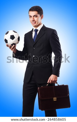 Young businessman with football on white - stock photo