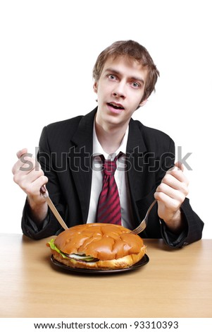 Young businessman with hamburger