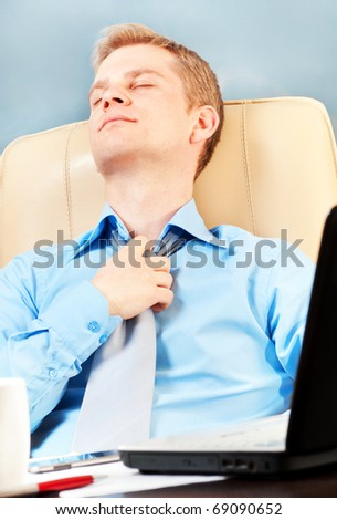 Young businessman with healh problems - stock photo