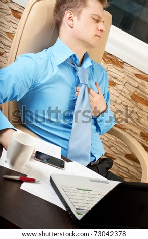 Young businessman with health problems - stock photo