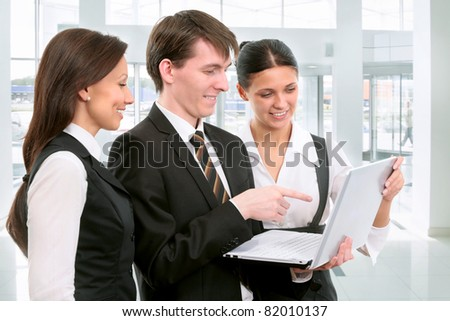 Young businessman with his collegues
