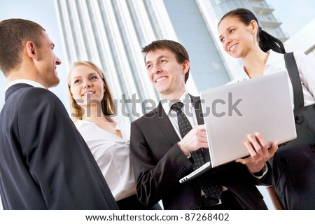 Young businessman with his collegues on the background of a modern office