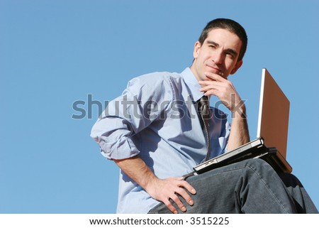 Young businessman with his laptop - stock photo