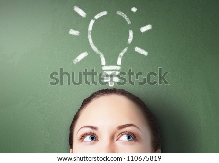 Young businessman with ideas as symbol of business creativity - stock photo