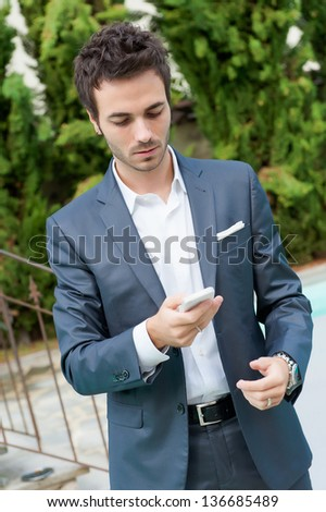 Young Businessman with Mobile Phone,Italy