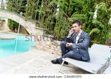 Young Businessman with Mobile Phone,Italy - stock photo