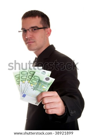 young businessman with money - stock photo