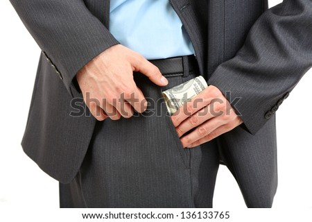 Young businessman with money isolated on white