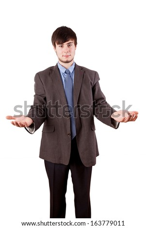 Young businessman with open hands - stock photo