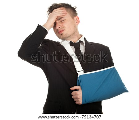 young businessman with pain and broken hand wearing an arm brace, series - stock photo