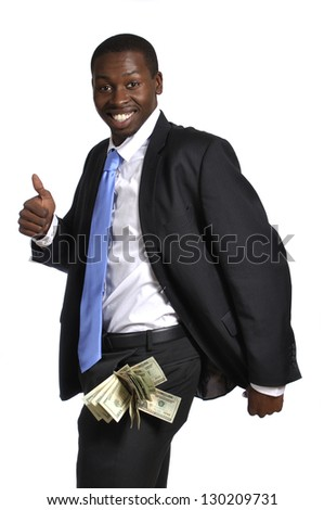 Young businessman with pockets fat of cash celebrates his success - stock photo