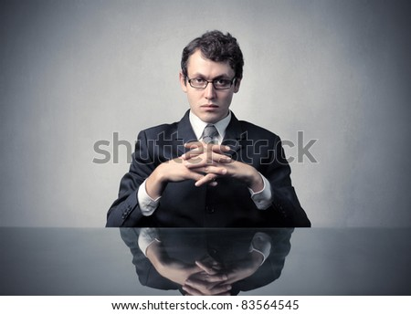 Young businessman with serious expression - stock photo