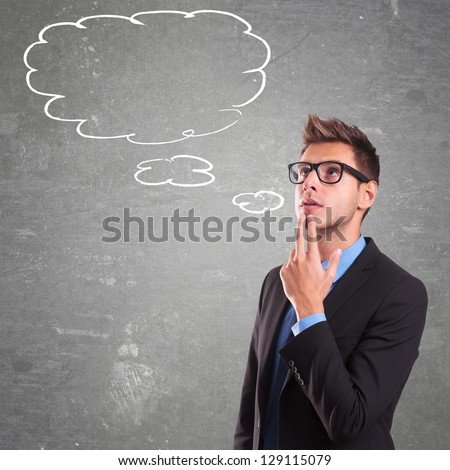 Young businessman with speech bubbles inside. Thinking man. Conceptual image of a open minded man.On a gray background - stock photo