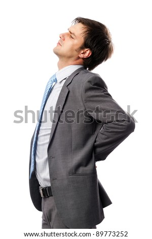 Young businessman with strong back pain, isolated on white background