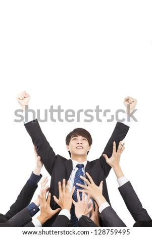young businessman with success gesture and group of support hands - stock photo