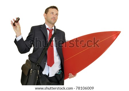 Young businessman with surf board recieving a call from the office - stock photo