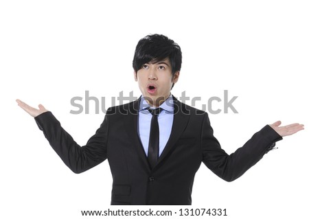 Young businessman with surprise expression on his face isolated - stock photo