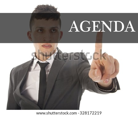 Young businessman with text agenda isolated on white background - stock photo