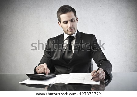 young businessman working at his desk - stock photo