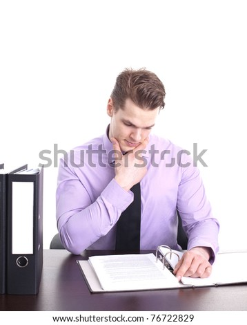 young businessman working at his desk, isolated on white
