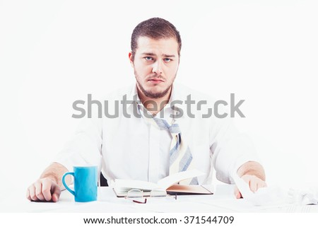 Young businessman working hard - stock photo