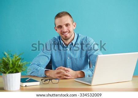 Young businessman working in modern office