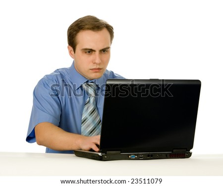 Young businessman working on a laptop. Isolated on white. - stock photo