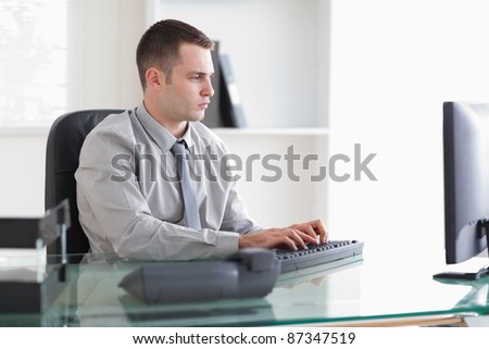 Young businessman working on his computer