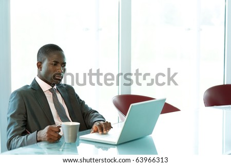Young businessman working on his laptop