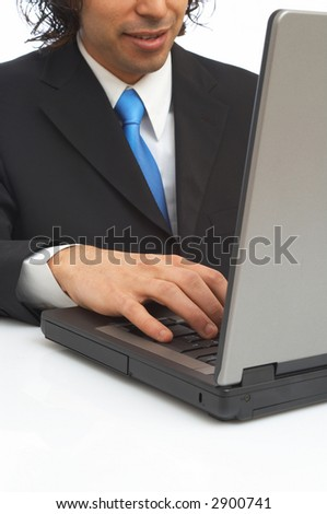 young businessman working on laptop with a happy face - stock photo