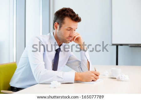 Young businessman working on perfect solution