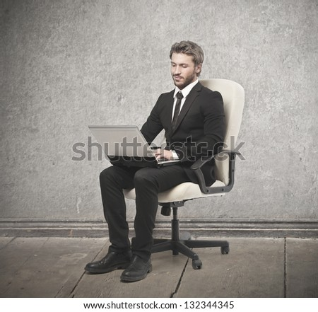 young businessman working on the chair