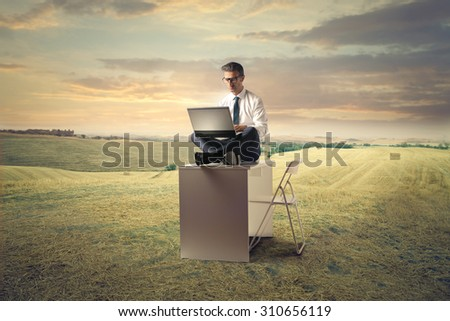 Young businessman working outside - stock photo