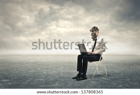 young businessman working with gas mask - stock photo