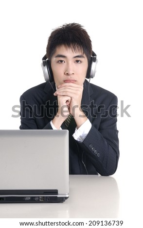 Young businessman working with headset and computer in office  - stock photo
