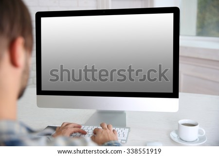 Young businessman working with his computer close up - stock photo