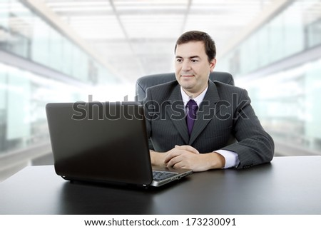 young businessman working with is laptop, at the office