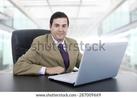 young businessman working with is laptop at the office - stock photo