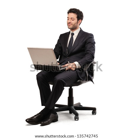 young businessman working with laptop - stock photo