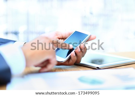 Young businessman working with modern devices, digital tablet computer and mobile phone. - stock photo