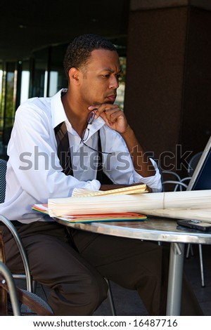 Young Businessman works on a computer outdoors