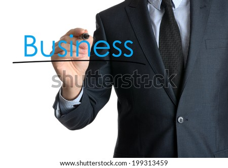 Young businessman writing Business on white background