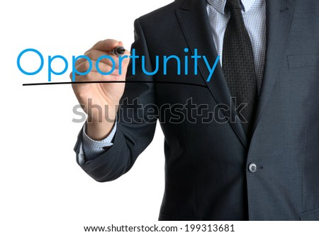 Young businessman writing opportunity on white background  - stock photo