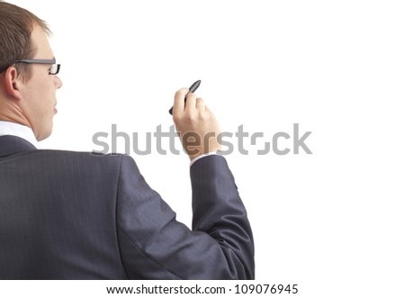 Young businessman writing something with a marker, back view - stock photo