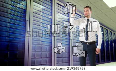 Young businessman writing with marker against server room - stock photo