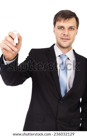 Young businessman writing with marker isolated on white background - stock photo