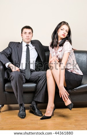 Young businessmen and woman-secretary in office